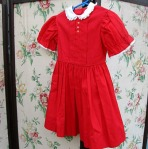 Red cotton full skirted little girls dress from the 50s 60s with puffed sleeves.