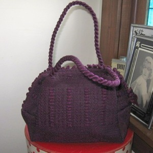 vintage plum purple nylon pocketbook that resembles a loopy pot holder