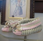 Never worn 1920s childs slippers in green and pink with flowers.